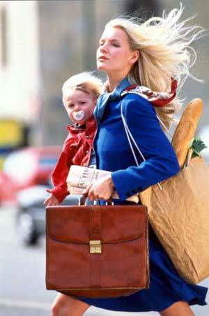 Poslovna majka s djetetom